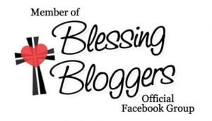 An image of the Blessing Bloggers badge. There is a cross with a heart in it next to the title.